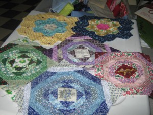 Some finished hand sewn squares