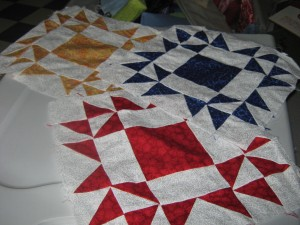 Some of Julie's squares for her quilt I need to finish.